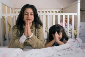 Parent praying with child